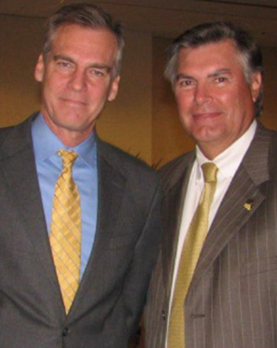 Louisiana Nursing Home Association. Two men in suites posing for a photo.