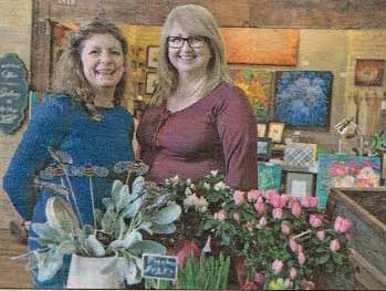 Business View Magazine's Associate Editor, Lorie Steiner (left) stands in Paris' Wincey Mills, with the market's community relations manager, Francine Tausney (right).