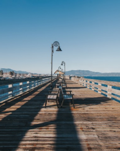 Campbell River. Looking down the length of a pier with benches and lights down the middle and railings on either side.