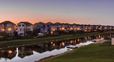 A view of a residential area in Airdrie Alberta. Home along a walkway and canal.