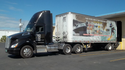 Fiberglass Coatings Inc. Semi truck pulled up to a building to get loaded.