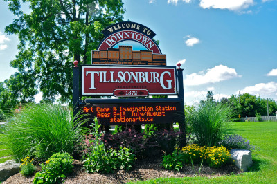 Tillsonburg Ontario. A welcome to Downtown Tillsonburg sign. Incorporated 1872. A light up sign below, with information on an Art Camp for summer.